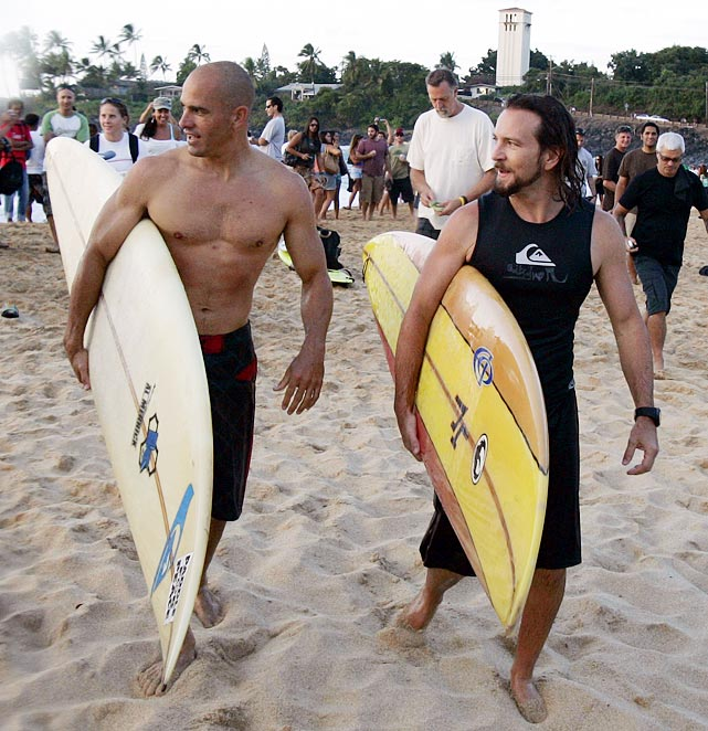 Kelly and Eddie prepare for the paddle out of the Eddie Aikau opening ceremony. Photo by Quiksilver