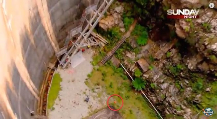 An exploding basketball wasn't part of the How Ridiculous team's trick. Ball (circled) is just about to impact the cement. Photo: Screen grab