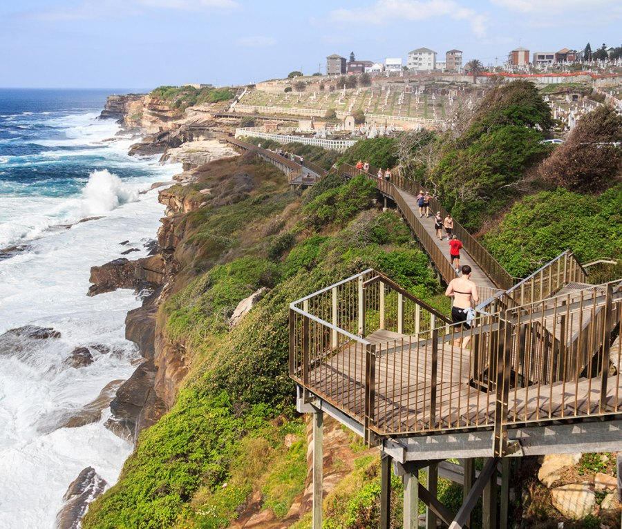 Walkers and joggers along the coastal path at Waverley, Sydney, which stretches from Bondi to Coogee