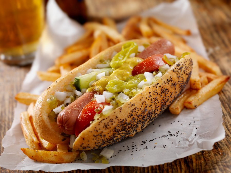 A Classic Chicago Dog with Fries and a Beer