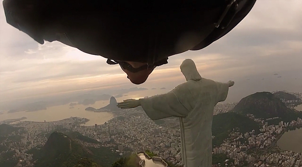 Tempting fate? A homage to a higher power? Badass? Combo of all three? A proximity flight in Rio de Janiero, underneath the arm of the Christ the Redeemer statue. Photo: Wingmen.