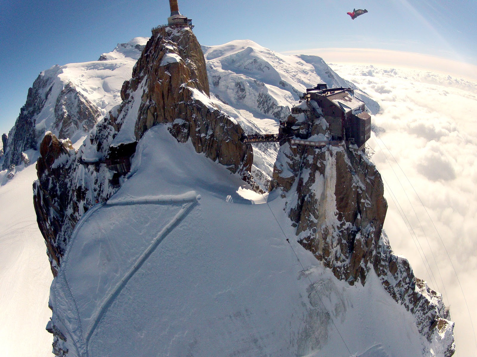 A flight in Chamonix. Threading the needle, the wingsuit fliers flew underneath the bridge at Aiguille du midi. Photo: Wingmen.
