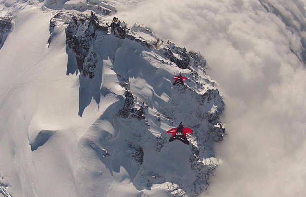 Jokke Sommer and Espen Fadnes fly over the Aiguille du Midi at the Mecca of base jumping, Chamonix. Photo: Wingmen.