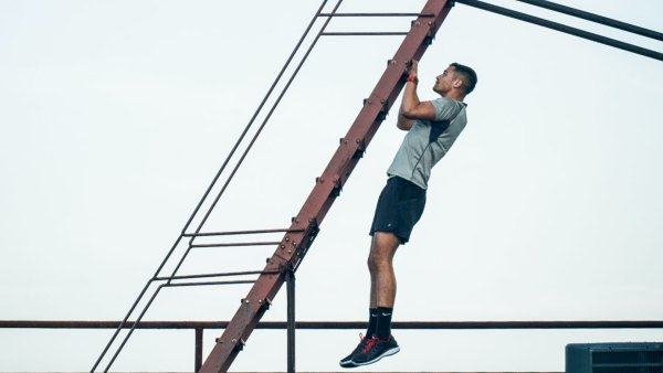 Man doing pullups on stairs