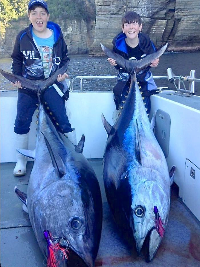 Sam Nichols, 12, (at left) and Toby Nichols, 10, simultaneously hooked and eventually landed world-record southern bluefin tuna in their respective age divisions. Photo: Personalised Sea Charters