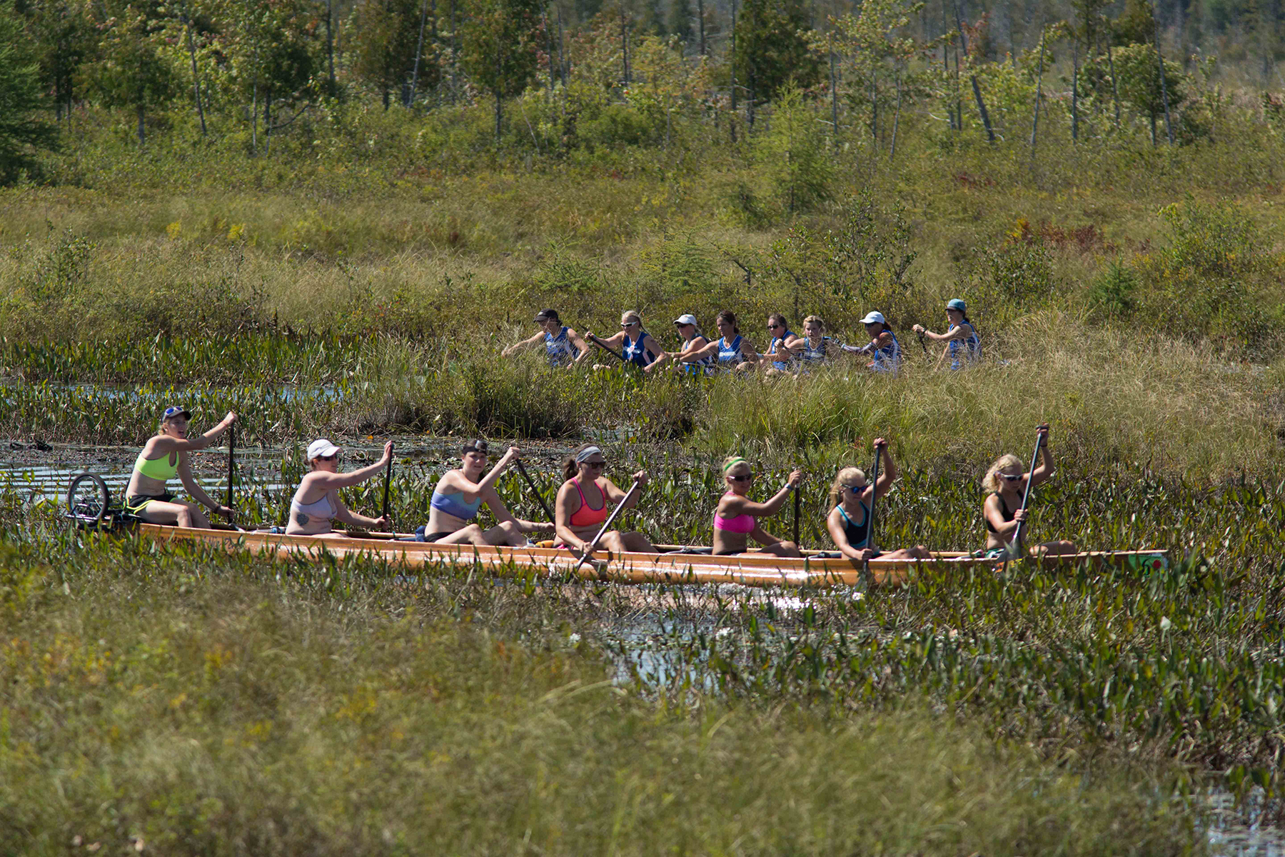 Paddlers race in the 3-day, 90-mile Adirondack Canoe Classic from Old Forge to Saranac Lake in New York state on Friday, September 11.
