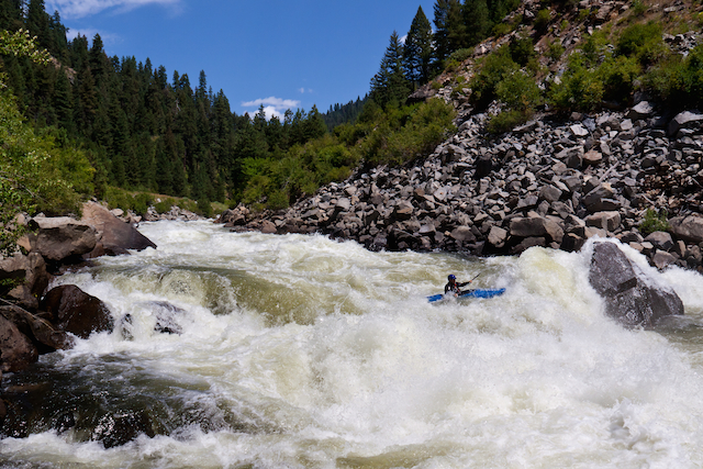"""Boyce Greer making the move at """"Rock Drop"""" in """"Jacob's Ladder"""" on the North Fork Payette River, Idaho. Mike Leeds photo."""