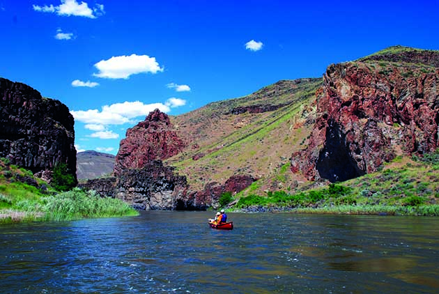 The Owyhee is rich with ancient history. Boaters float past Potters Cave–an historic rock shelter–on river right. Photo by Thomas O'Keefe