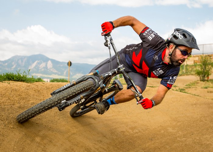 Mountain bike instructor Lee McCormack demonstrates a cornering move that initiates from the slow hip hinge movement he teaches and preaches to all riders. Photo: Leslie Kehmeier