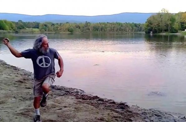 Stone skipper Kurt Steiners winds up before skipping a rock across Lake Paran in Vermont. Photo: Screen grab