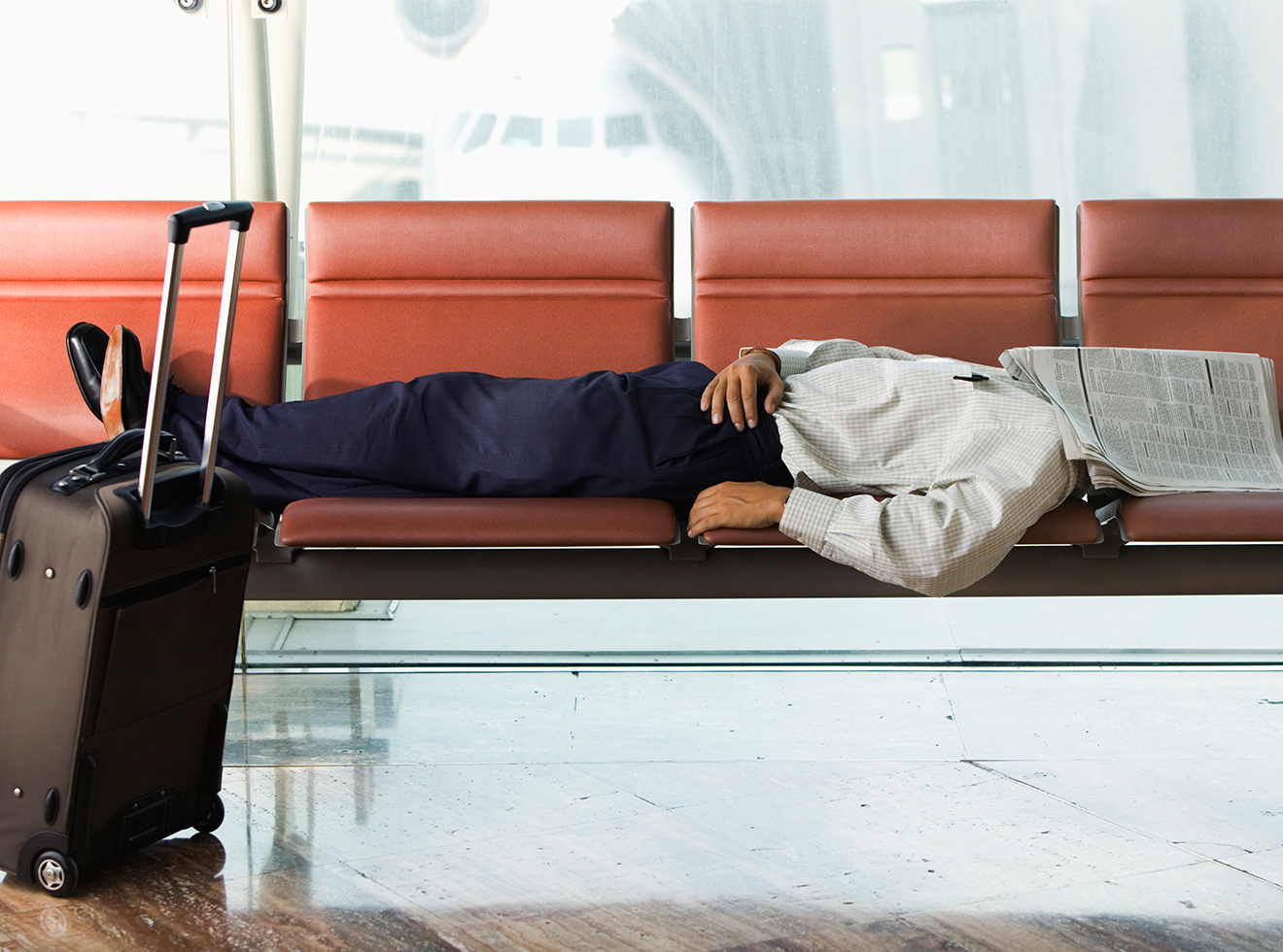Man Sleeping in Airport Terminal