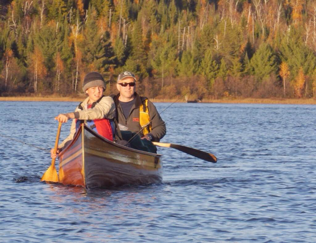 Joseph and Jeff in wood canoe they built