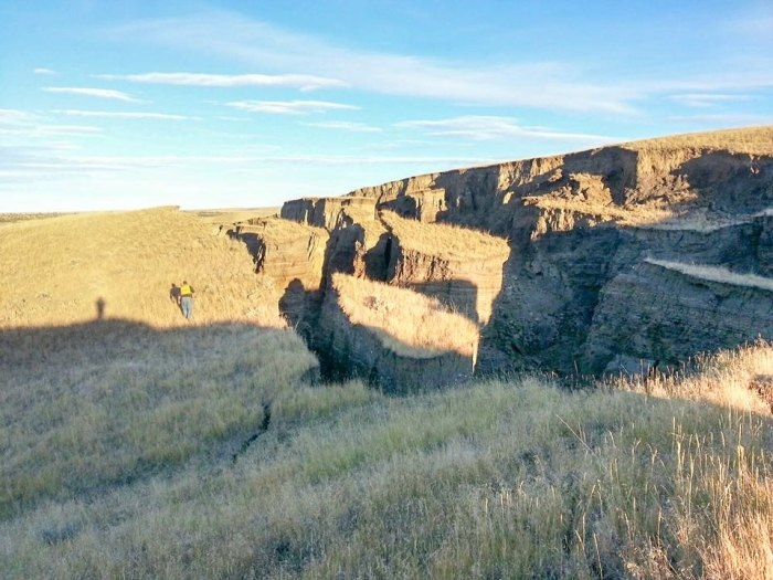 A giant hole opened up on private land in the foothills of the Bighorn Mountains.