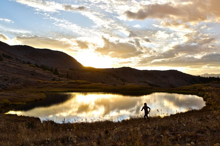 Tricia Collins is making the most of the cross-country scenery, training hard for a half-marathon she's running shortly after the trip is over. Photo: Jody MacDonald