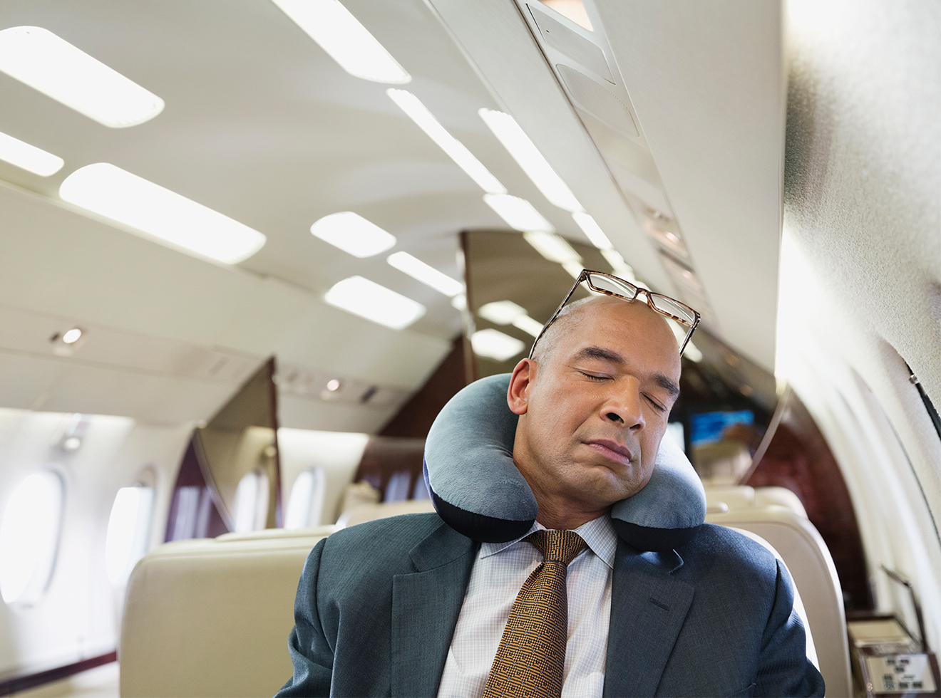 Businessman sleeping in private jet