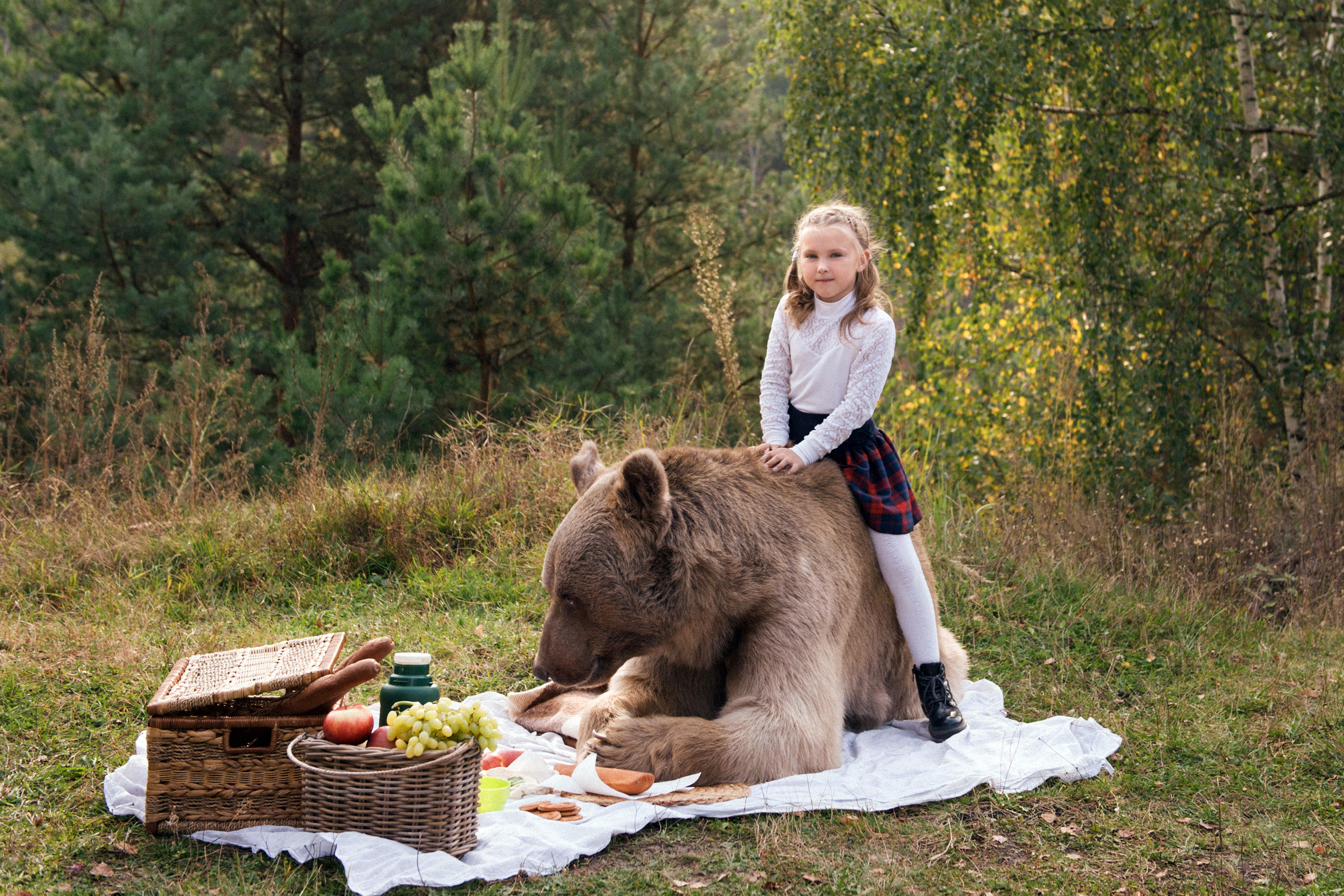 Katya was hesitant around the grizzly bear at first but quickly warmed up to it.