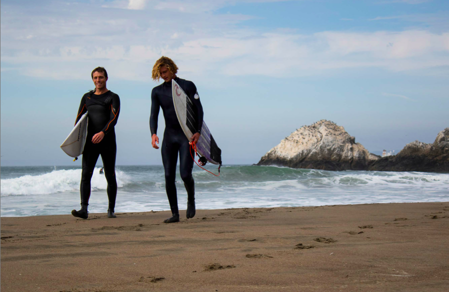 SURFING Magazine's editor-at-large Taylor Paul exits the water with friend Noah Wegrich after their first surf in San Francisco.
