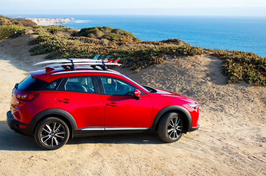 The new Mazda CX3 — the cherry chariot for the San Francisco to Santa Cruz road trip — waits for the boys to wrap up a surf check along Highway 1.