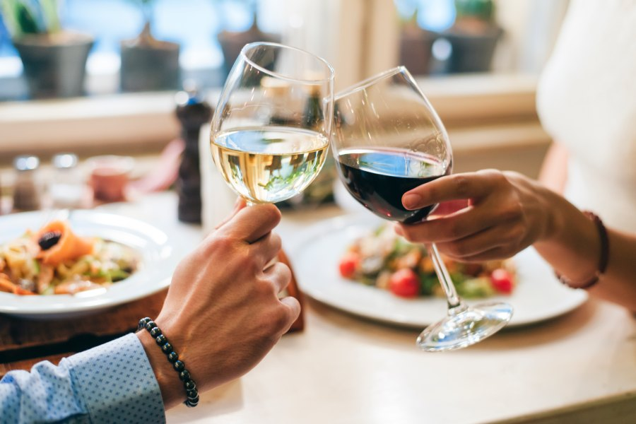 Couple toasting with wine glasses