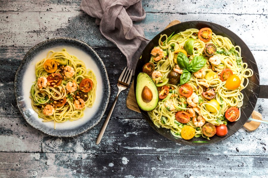Plate and frying pan of zoodles, avocado, tomatoes, and shrimps; weight-loss tricks