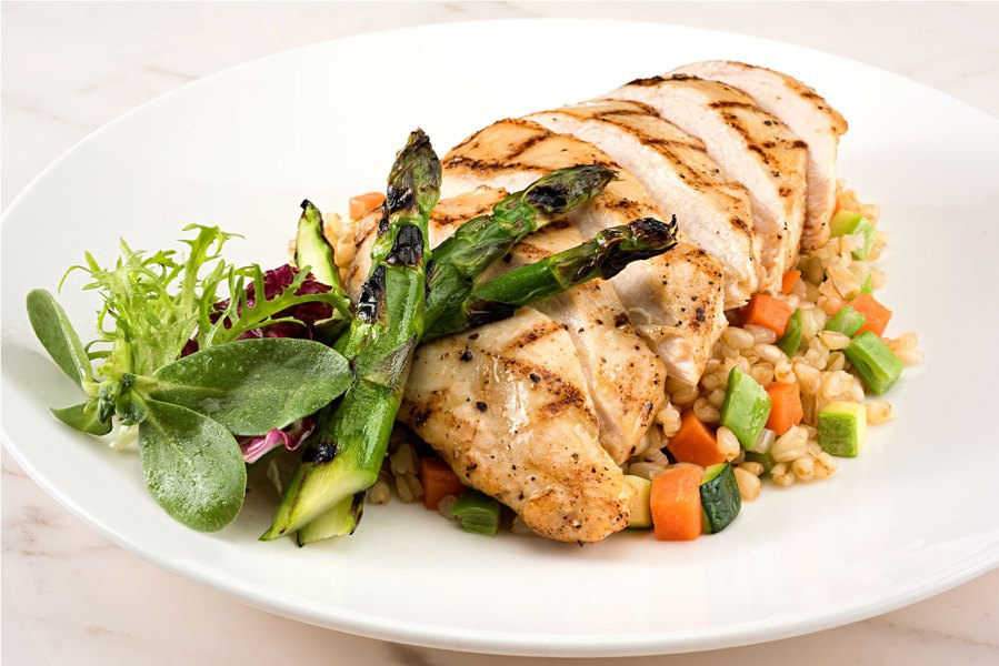 Grilled Chicken Breast with Garnish and Asparagus