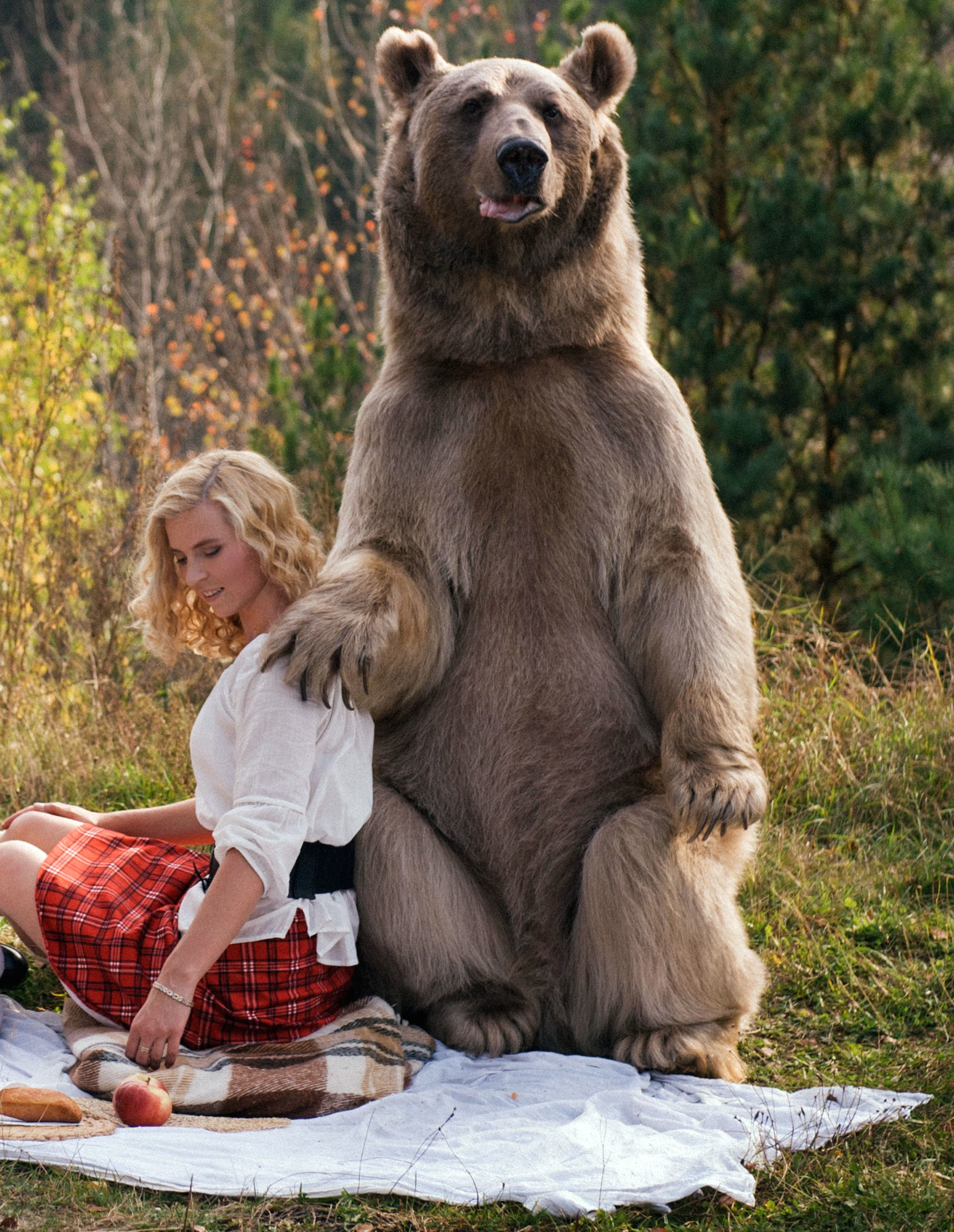 Grizzly bear named Stepan looks intimidating posing next to model Irina.