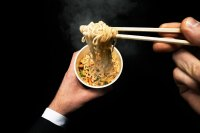 man-eating-noodles-with-chopsticks