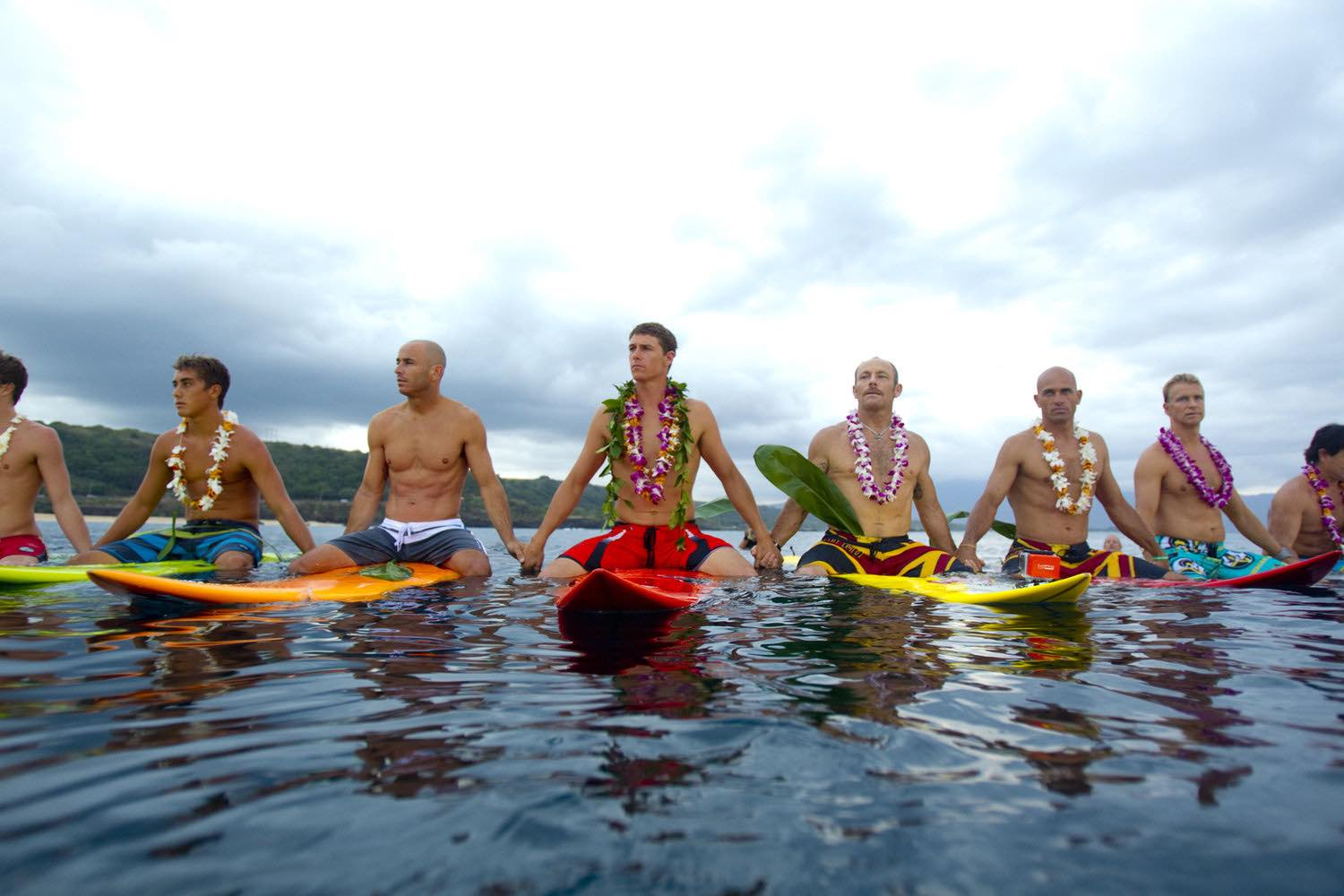 Tom Carroll (holding hands with Kelly Slater, to his right) at the Eddie Aikau Opening Ceremony. Photo: Courtesy of Quiksilver