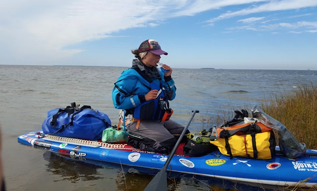 LouAnne Harris takes a much needed break on her loaded board. Not easy paddling 1500 miles! Photo: Atlantic SUPergirls