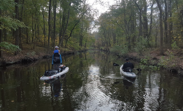 A guide helps the SUPergirls navigate a creek on their way from Virginia Beach to North Carolina. Photo: Atlantic SUPergirls