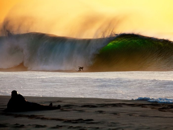 Hawaii's Pipeline is always beautiful, but there's something about sunset. Photo: Courtesy of National Geographic