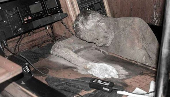 Fisherman found the mummified captain slumped over in the cabin of the ghost ship.