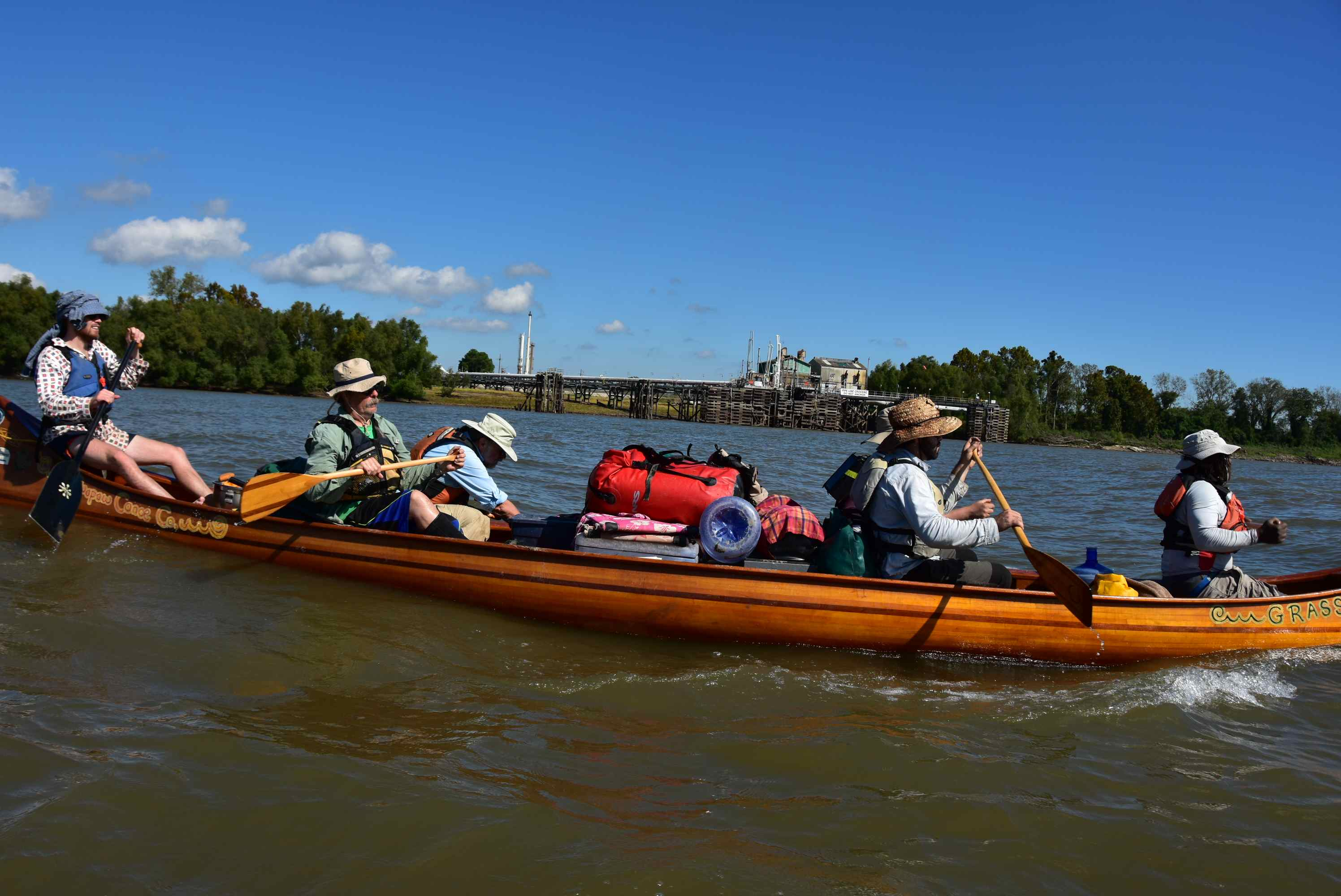 """The """"Why Paddle the Mississippi,"""" crew cruising toward the Gulf of Mexico in their voyageur canoe. Photo John Ruskey"""
