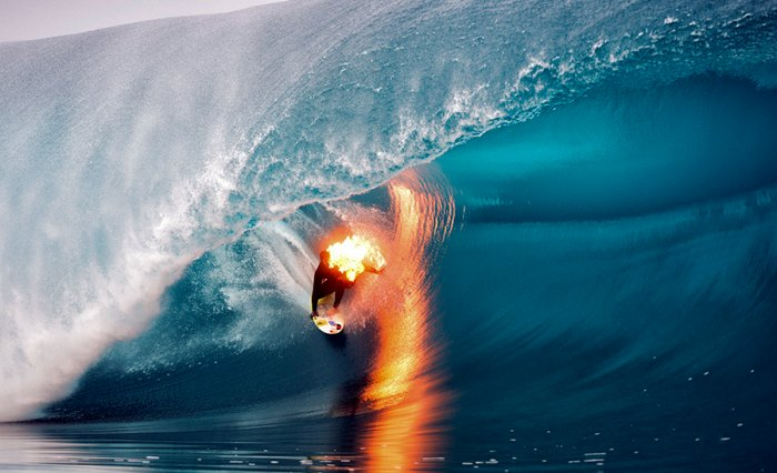 Jamie O'Brien tackles Teahupoo (while on fire). Photo: Courtesy Tim McKenna/Red Bull Content Pool