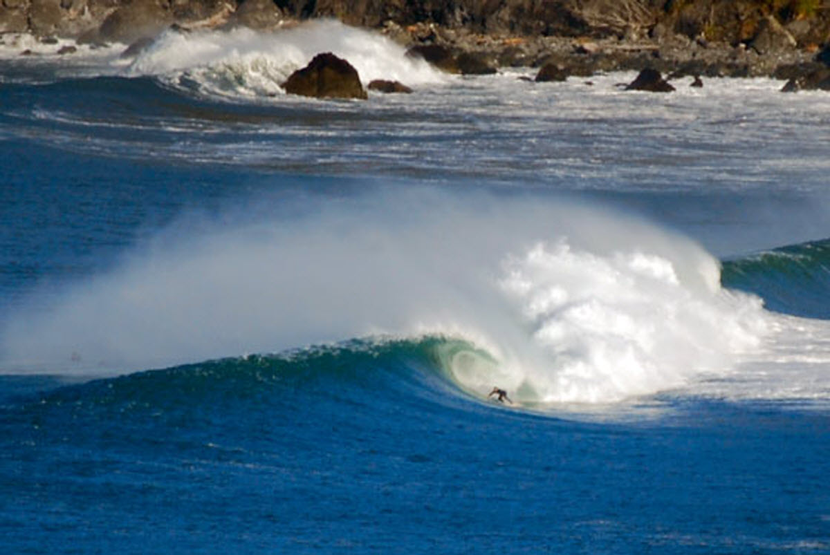 A surfer at the legendary, and rather dangerous, Klamath Rivermouth. Photo by Extremesports.com
