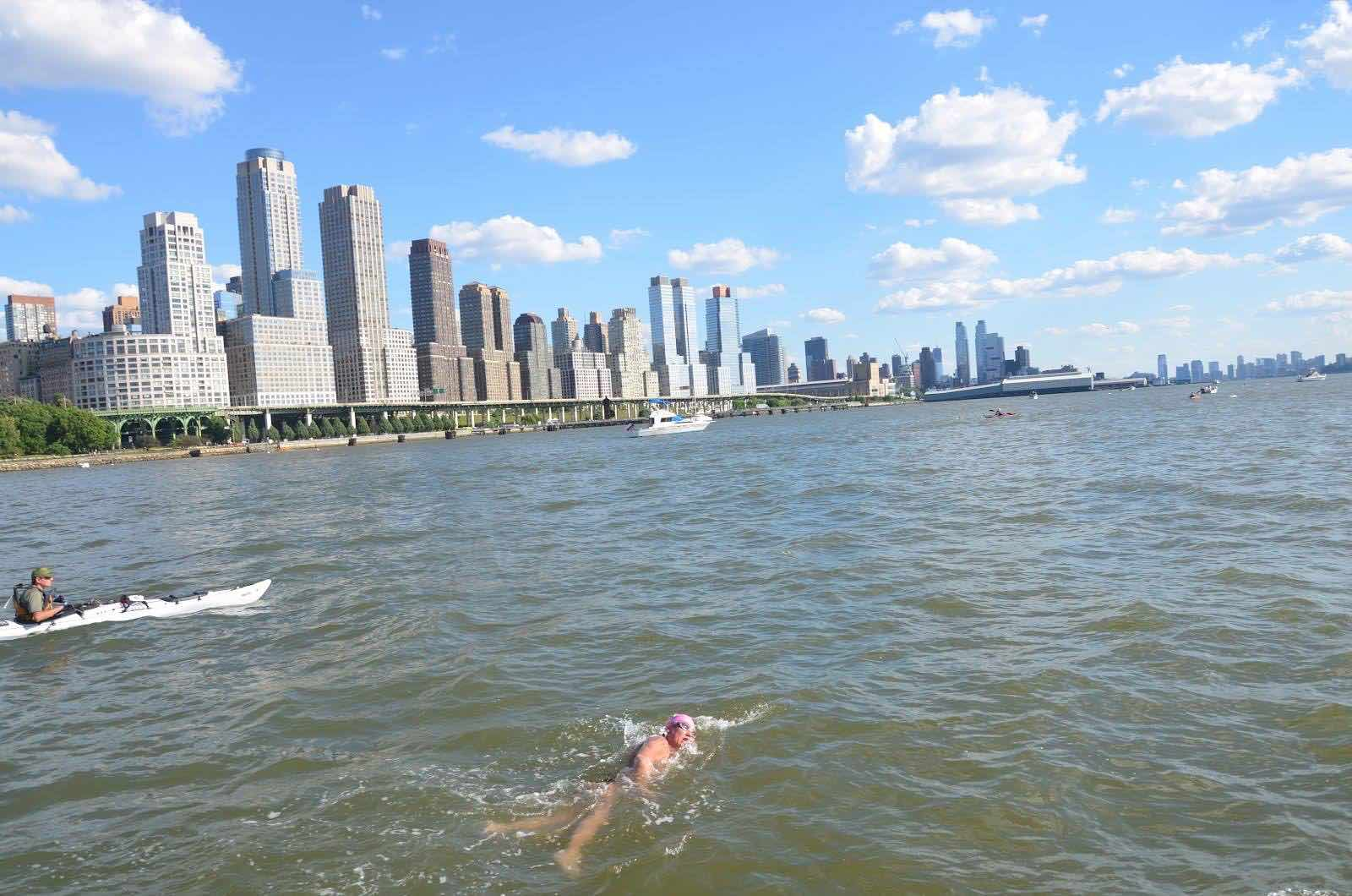 A swimmer takes in the Manhattan skyline (well every second breathe). Photo NYC Swim