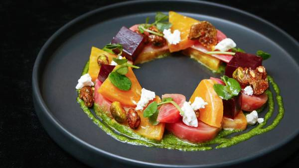 A Colorful, Mint Pesto Beet Salad with Goat Cheese and Candied Pistachios