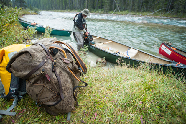 A canvas pack being used on a canoe trip in Alberta. Photo by Aaron Schmidt.