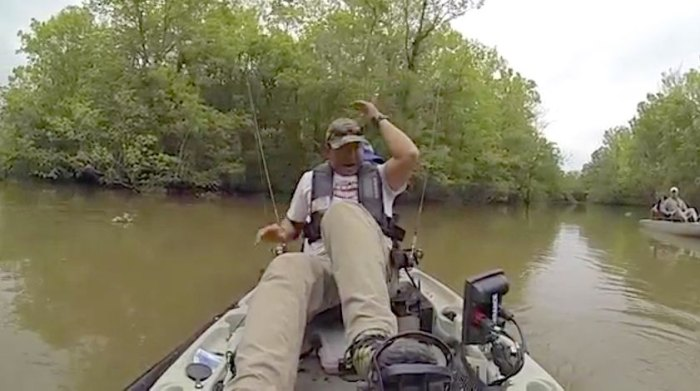 Lance Burgos reacts after pulling in a jug line and seeing the massive jaws of a huge alligator.