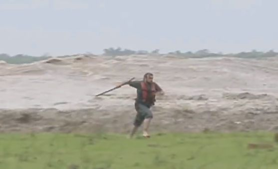 Brazilian TV host suddenly realizes he's about be swept away by a massive tidal bore and acts accordingly.