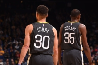 Stephen Curry #30 and Kevin Durant #35 of the Golden State Warriors are seen during the game against the Phoenix Suns on February 12, 2018