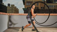 Man whipping battle ropes