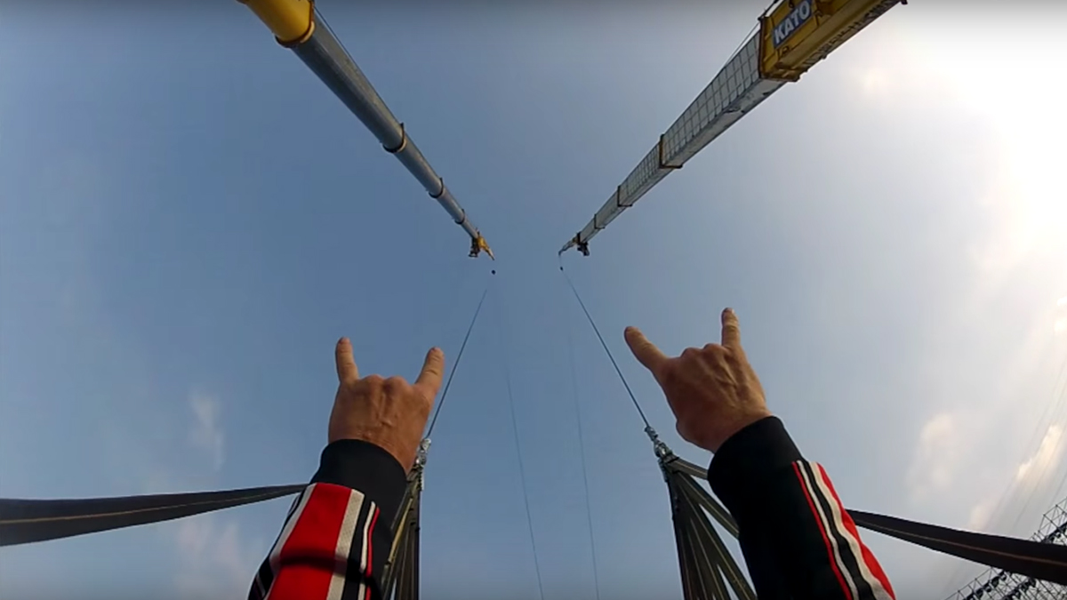 Make sure to throw those metal horns up before getting catapulted into a BASE jump.