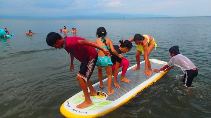 The inflatable SUPs were a hit with the Tico kids.