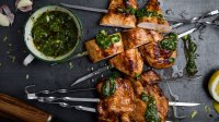 Barbequed chicken breast skewers with chimichurri sauce