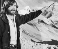 Italian mountaineer Reinhold Messner points to a photograph of Mount Everest after his unprecedented solo ascent without supplementary oxygen, 1980.