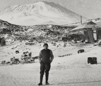 Ernest Shackleton with the volcano Erebus in background during his expedition to Antarctica on August 28, 1909.