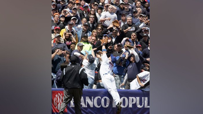 Third baseman David Wright #5 of the New York Mets dives into the crowd to catch the third out of the first inning against the New York Yankees who left the bases loaded on May 22, 2005 at Shea Stadium in Flushing, New York. (Photo by Jim McIsaac/Getty Images)