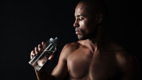 Man drinking water; weight loss goals