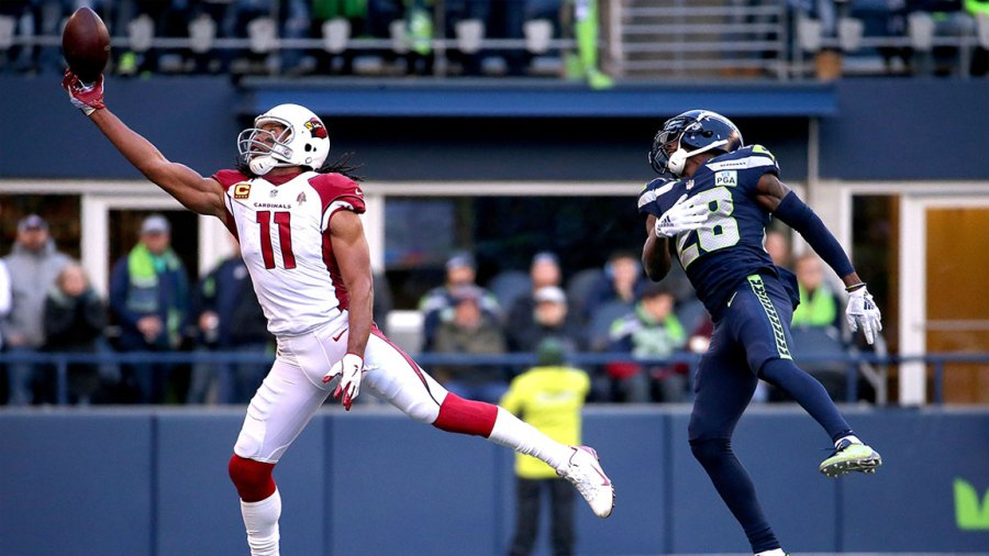 Wide Receiver Larry Fitzgerald #11 of the Arizona Cardinals makes a play in an NFL game.